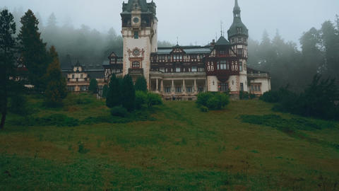 Peles Castle and a Misty Pine Tree Forest in Sinaia, Transylvania, Romania - Wid Footage