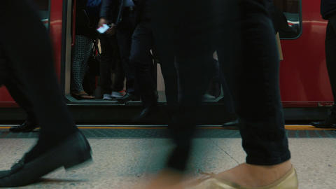Low Angle Shot Of Commuters Boarding A London Underground Tube Train stock footage