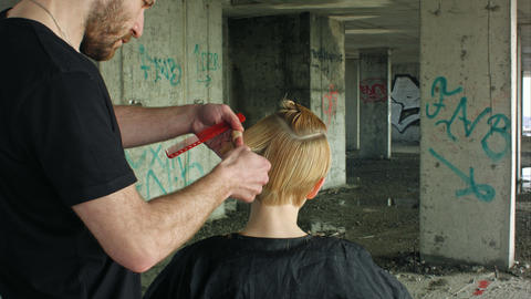 Hairdresser Giving A New Haircut stock footage
