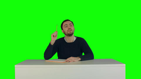 Students With Book Listening During A Lecture On A Green Screen stock footage