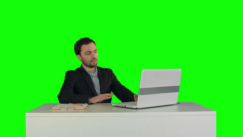 Smiling Businessman In The Office On Video Conference, Skype On A Green Screen stock footage