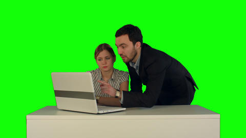 Couple Discussing New Project On The Laptop. Teamwork Concepts. On A Green Scree stock footage