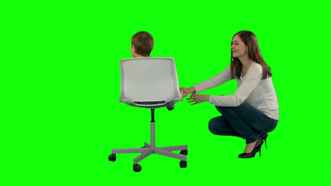 Mother And Boy Play Game On A Green Screen stock footage