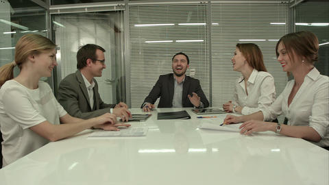 Casual business team laughing during meeting in the office Footage