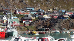 Greenland Small Town Qaqortoq 076 Tenderboat Of A Cruise Ship Crosses Harbor Sce stock footage