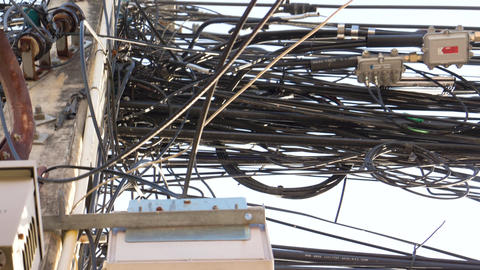 Electrical Wiring On A Typical Asian Rural Street stock footage