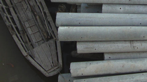 Concrete Pilings Ready For Transport By Traditional Asian Boat stock footage