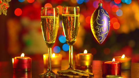 Two Flutes with Sparkling Champagne with New Year decoration Footage
