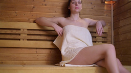 Woman Leaving Sauna Cabin After Relaxation stock footage