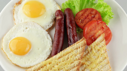 English Breakfast With Fried Eggs, Sausages, Toasts And Fresh Salad stock footage