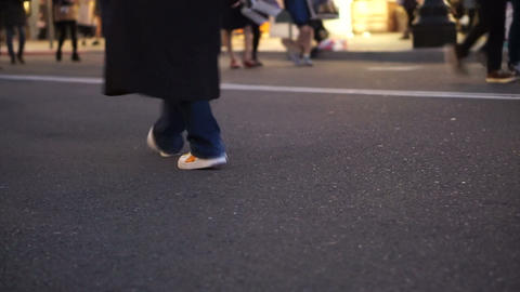 Detail View Of Feet Of Walking People At Shopping Street In Evening stock footage
