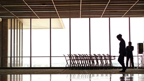 Time Lapse Silhouette People Walking In Airport. Silhouettes Of A Crowd Of Backl stock footage