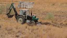 Tractor Building A Road In The Desert stock footage
