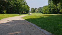 three golf player walking down the sand path to the next hole Footage