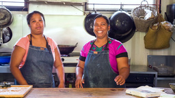 two women cooking in outdoor kitchen in mauritius B Footage