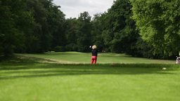 Woman Playing A Drive At A Golf Course stock footage