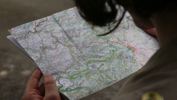 woman searching for way on map Footage