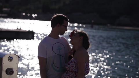 silhouette of a loving couple on a background Solar path on the water Footage
