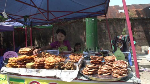 Yangon, Woman With Tanaka At Stall stock footage