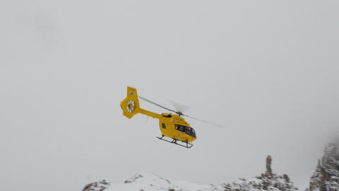 Mountain Helicopter Snowy Dolomites Three Peaks 11752 stock footage