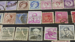 An International Stamp Collection. Hobby. Philately. Zoom Out Shot stock footage