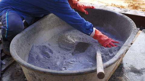 Mixing Cement For Construction. Prepare Powder Concrete And Hand Sourcing Out stock footage