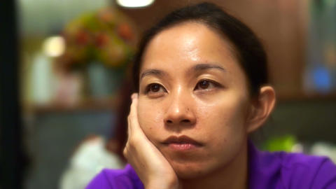 Bored Asian Woman Sitting Around Hand On Face And Looking Distance In Restaurant stock footage