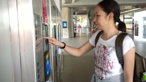 Girl tourist buying subway or train tickets at the ticket machine Footage