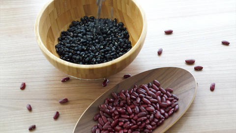 red and black beans Vegetarian multigrain protein food, pouring to fill the wood Footage
