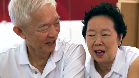 Happy Senior Asian Couple Playing And Have Fun With Humor stock footage