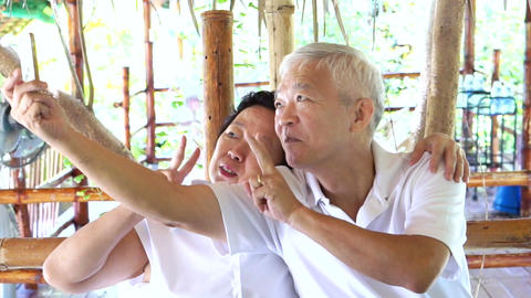 Happy Asian Senior Couple Taking Selfie stock footage