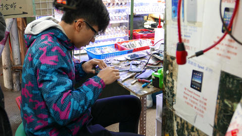 Young master in repair on knee market service, work with cell phone Footage