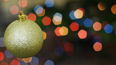 Christmas golden ball rotates at bokeh. Title area Footage