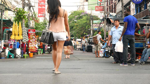 Unidentified Young Thai Women Cross Chakrabongse Road, Legs Level View stock footage