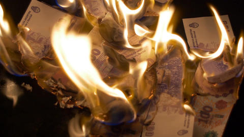 Burning 100 Argentinian Pesos Bills stock footage