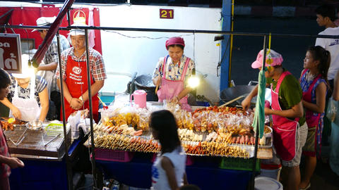 Stall Full Of Cooked And Raw Satay, Dried Foods, Snacks In Plastic, Night Street stock footage