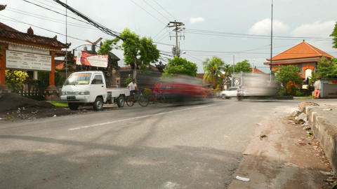 Ghostly traffic sunny road, low angle, balinese street, timelapse shot Footage