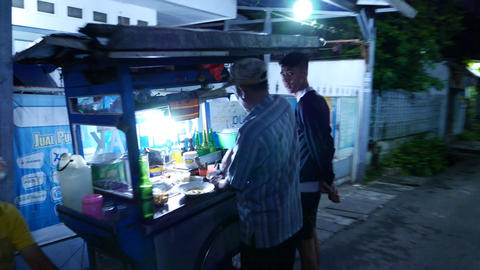 Cook Make Food On Dark Street, Mobile Kitchen On Tricycle stock footage