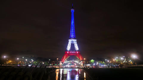 A Timelapse View On Eiffel Tower In Paris By Night With France Flag Colors stock footage