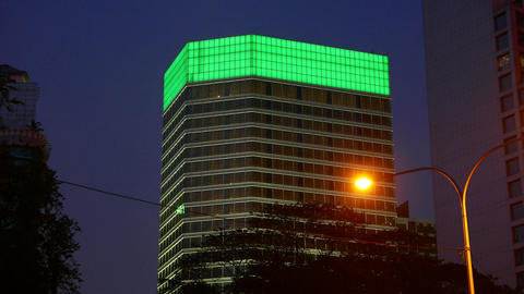 Illuminated Billboard At Skyscraper Top, At Dark Sky. Color Changes To Green stock footage