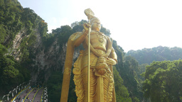 Amazing Golden Murugan Statue From Low Angle, Batu Caves Entrance stock footage