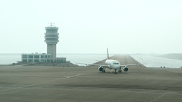 TransAsia Airways Plane Taxiing Out Of Runway, Turn To The Terminal Parking Area stock footage