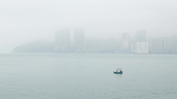 Two Fishermen In A Tiny Boat, Against Foggy Misty Land Shore stock footage