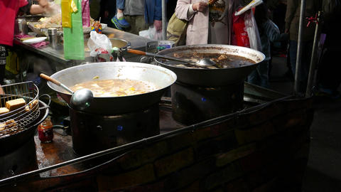 Two wok with boiling broth, open kitchen restaurant on night market Footage