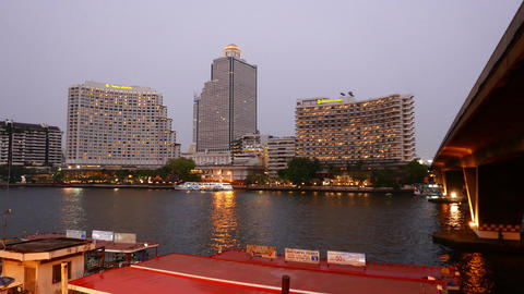 Hotel Buildings And Tower On Riverbank In Dusk, Sweet Hour Lighting stock footage