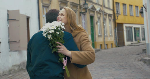 Man Giving Bunch Of Flowers To Woman stock footage