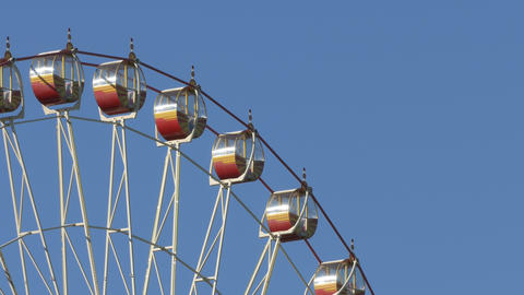 4K Ungraded: Ferris Wheel At Amusement Park Against Blue Sky stock footage