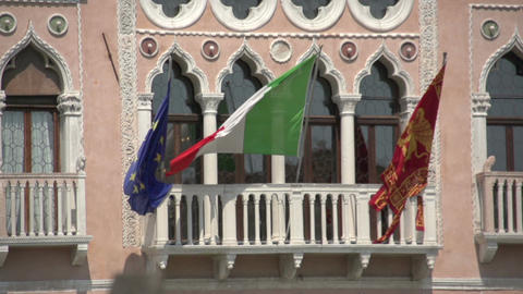 Italian, Venetian And European Flag In Slow Motion On House In Venice stock footage