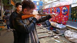 Young Man Shooting From Toy Rifle, Shooting Gallery stock footage