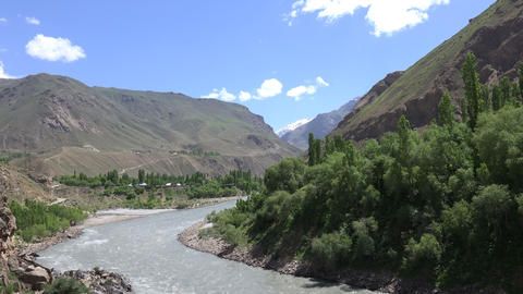 River Flowing Through Mountains, Pamir Mountains, Tajikistan stock footage